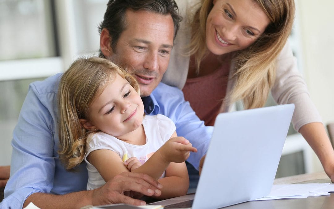 Family looking at school websites together