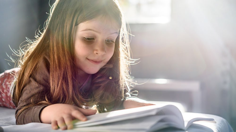 Little girl reading a book